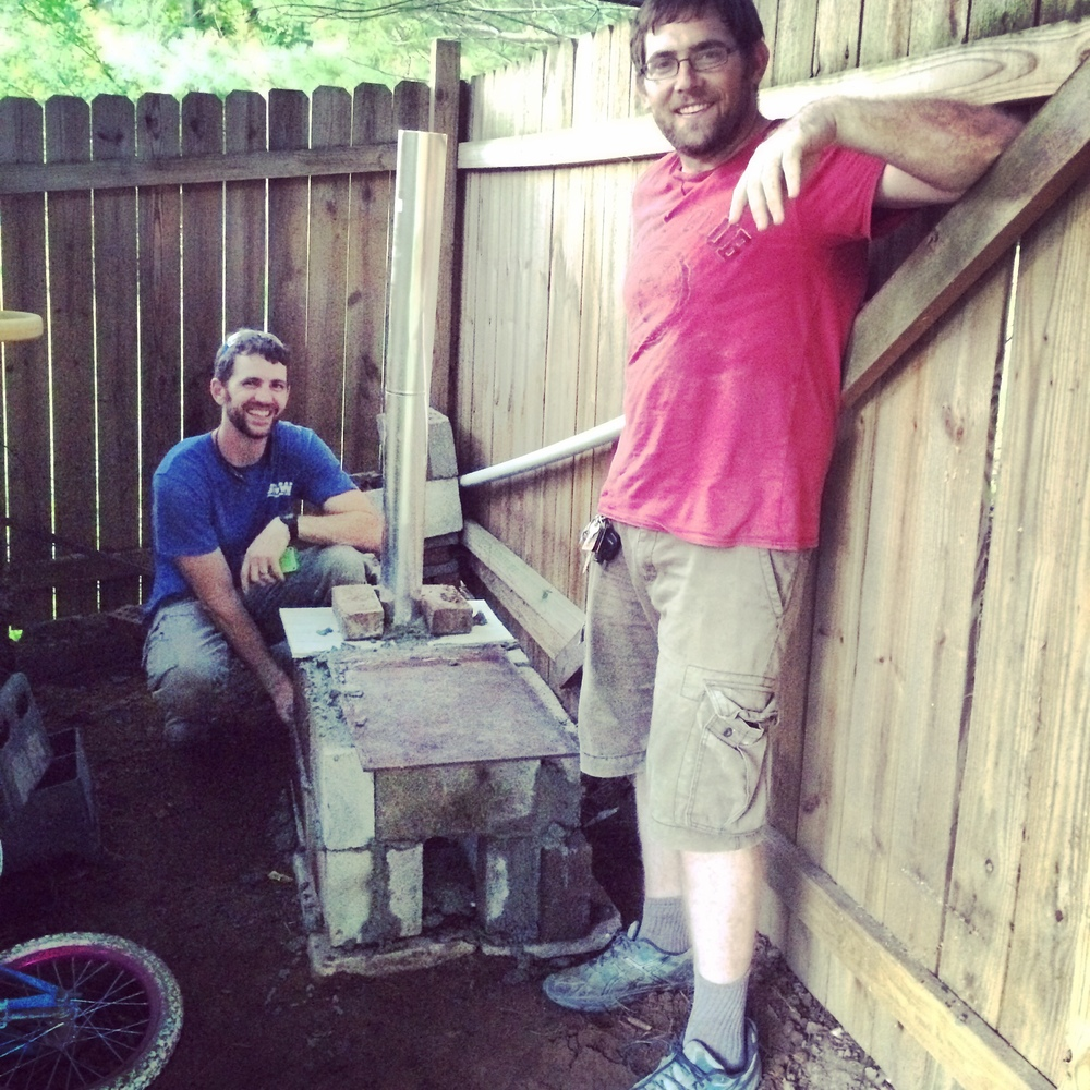 Michael Johnson and Jeremiah Watson constructed a rough prototype rocket stove in Tennessee.