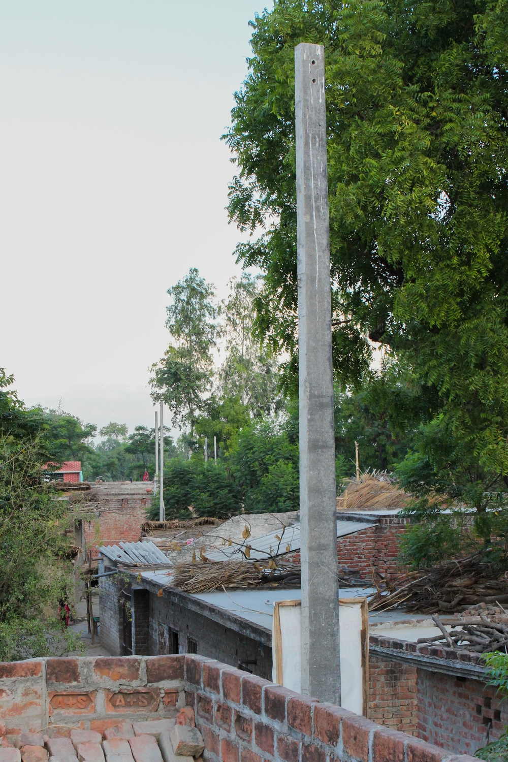 These concrete poles were set by the government to give light service to the village. They have no wires in them at all, and have been empty for over half a year, when they were installed.  This means that the faulty solar panels are the only source of electricity for this village.