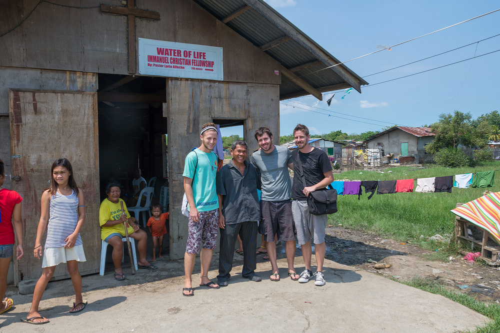 Chris Cameron (right) visiting a church in the Philippines alongside his brother Nate, and full-time development worker, Clark Miller.