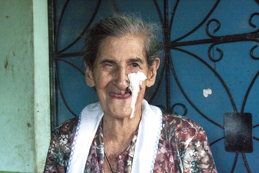 Mama Tula, midwife.