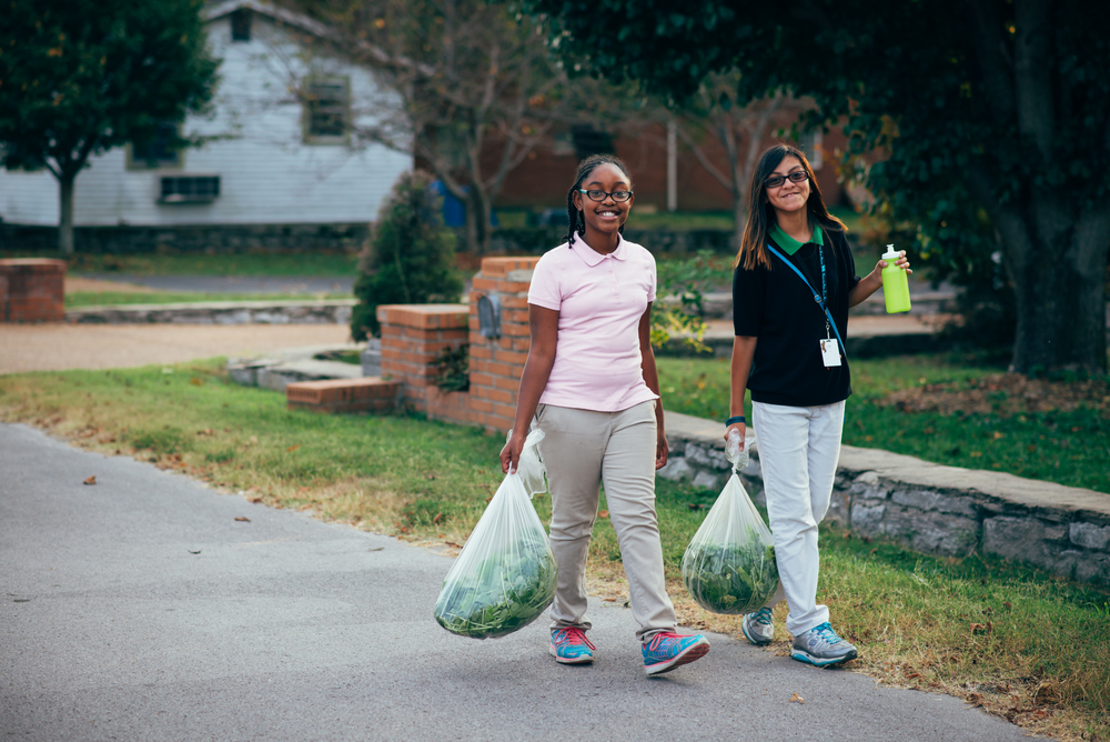 "C.A.S.E. students walk deliveries to neighbors in Hopewell. Geoff Hartnell reflects, ""Kids are typically really worn out by working in the garden. But when they get to deliver the produce to neighbors, they really love it."""