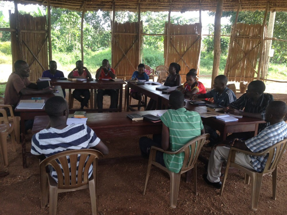 Students gather in our outdoor meeting area for their Old Testament class, taught by G.O.D. EA cooperative Peter Kimbugwe.