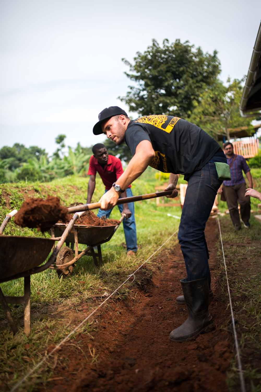 The men on the team were busy with a wide variety of projects that will help our land to become a safe and hospitable environment. Here, Ben Young creates a stone pathway for walking around the land so that far less mud is tracked inside of homes, a major problem in the rainy seasons.