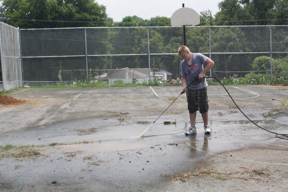Volunteers helped resurface the basketball court after it had suffered years of neglect.