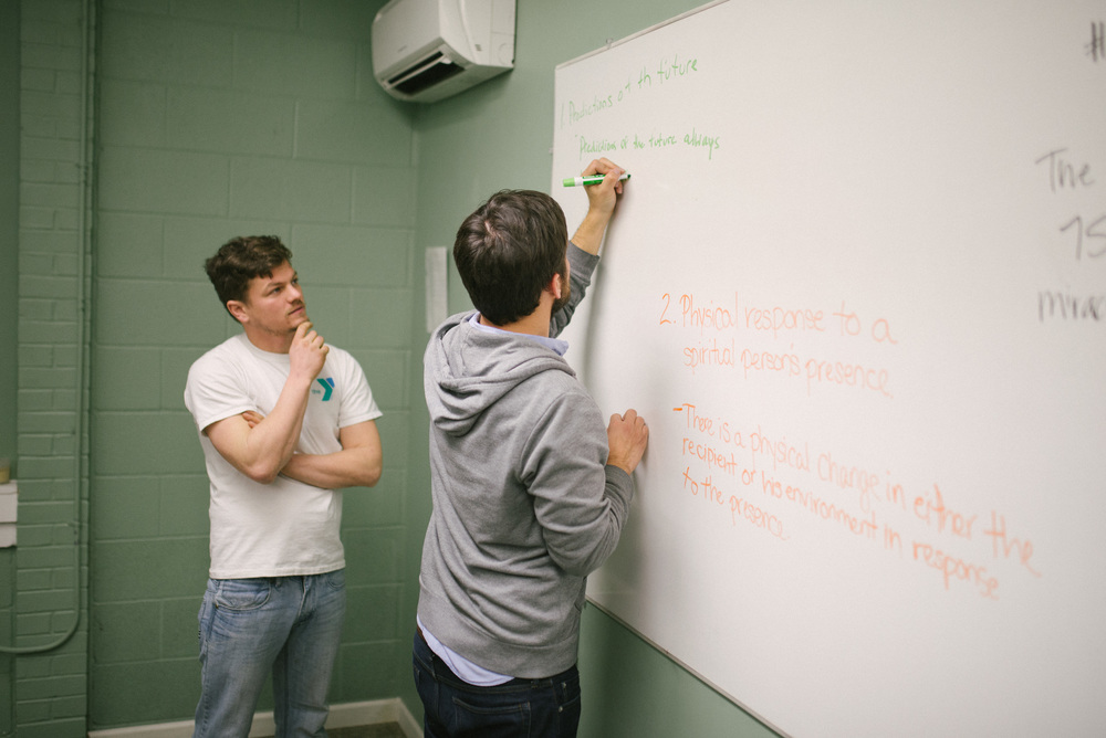 Benjamin Reese and Jason Carpenter share the results of homework they did together throughout the week. Continued education classes allow more class participation because everyone in the class has already received a Biblical education.