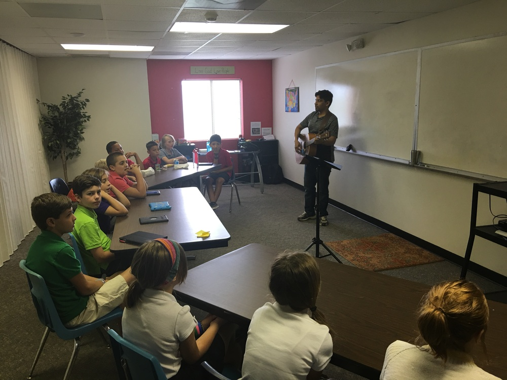 "Mr. Munoz taught students the song ""Father, I Adore You"" during Beginnings (our first block of the day). This will be something we implement quite often for this class block - opening up the day in prayer and worship to the Lord."