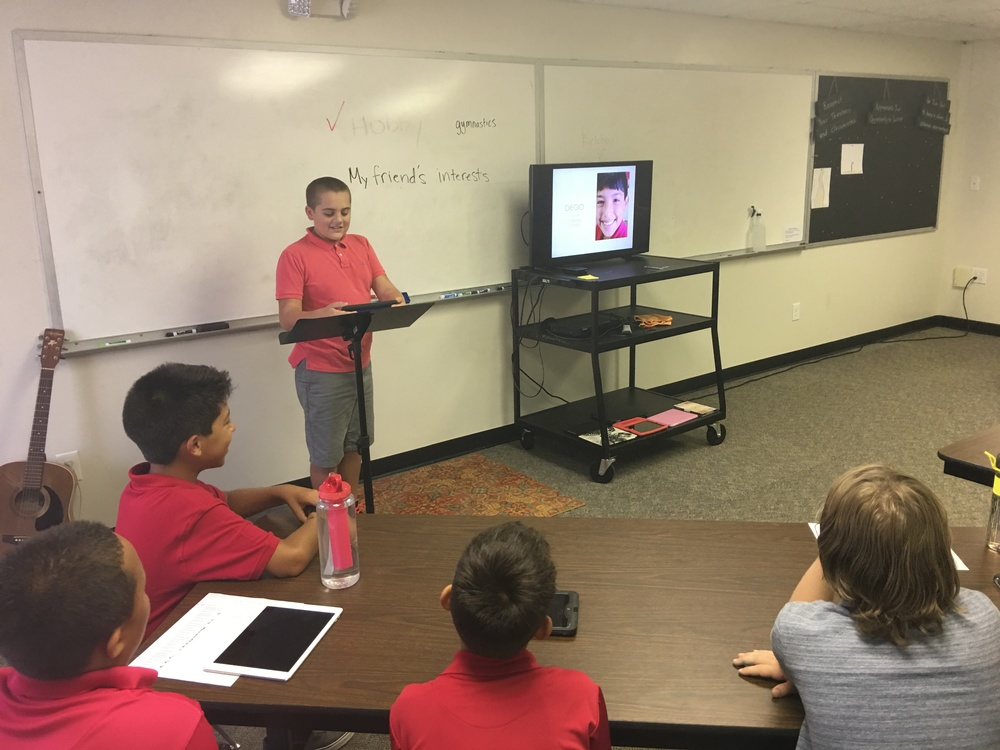 Students created Keynote presentations about other students in the class and their top three interests. Then several students volunteered to present their findings to the entire class. Here is Desmond talking about his new classmate Diego, whose favorite activity is playing soccer!