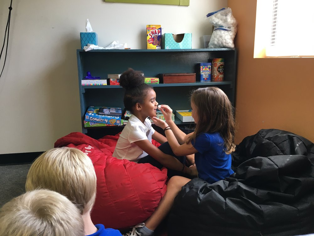 Girls will be girls, Nanozi and Eliana putting on makeup during free time! Our students get 4 slots for recess, taking a break, or free time everyday!