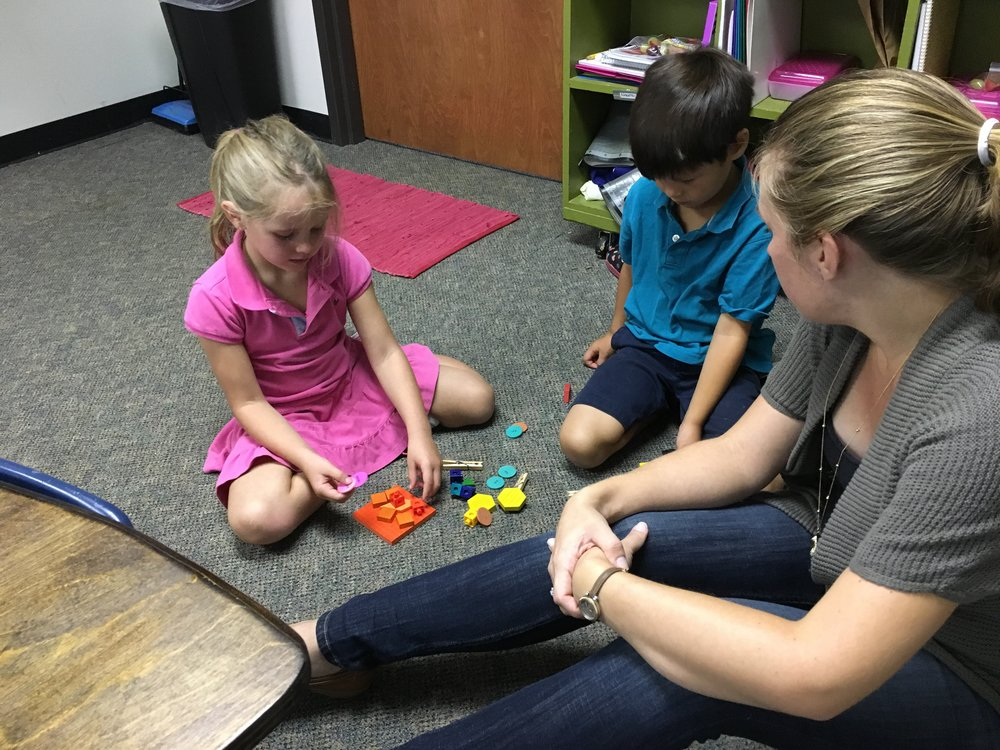 Mrs. Gowen (our Numbers teacher, who is so great with the students) is working with Xavier and Reyah who were grouping theirs by how each object felt when they touched it. It was great seeing the different ways our students grouped their objects.