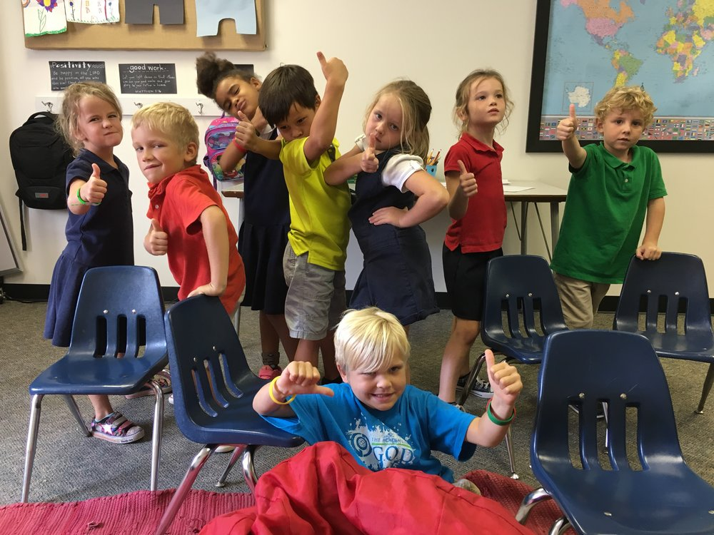 After the story, the students gave a thumbs up for taking time with family this week. Along with funny poses! Lol.