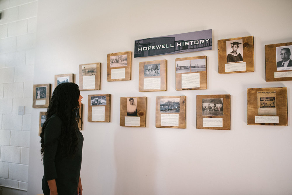 If you visit our headquarters, the Hopewell History wall will be one of the first things you see when you walk in our front doors.