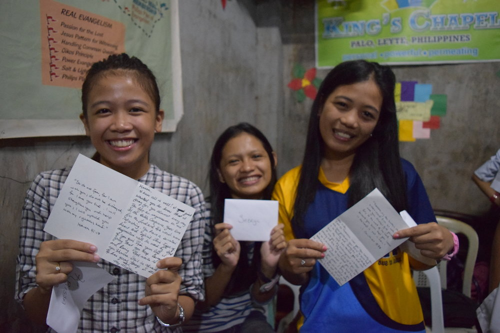 Filipino youth read letters from members of our organization whom they have become acquainted with recently.