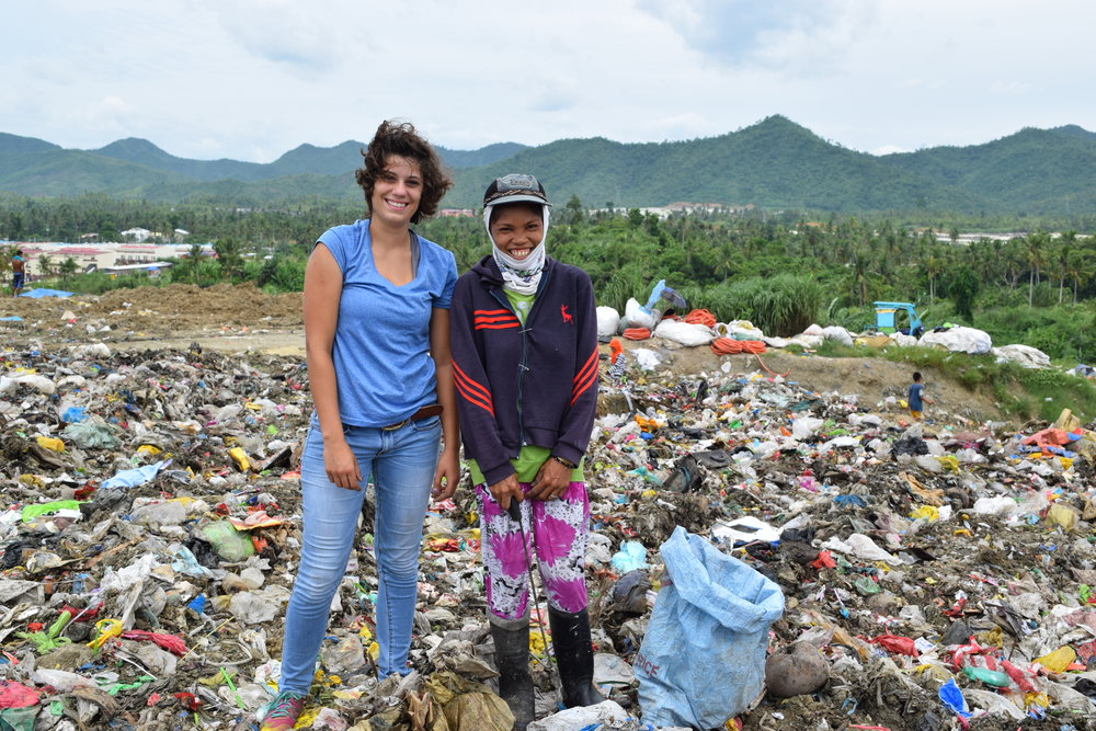 "Kennedy Dupuis works with the laborers at the Tacloban City dump on summer internship 2016.  The experience brings awareness to the difficulty of the lives of the poor and prompts the question, ""What do I do about this?"""