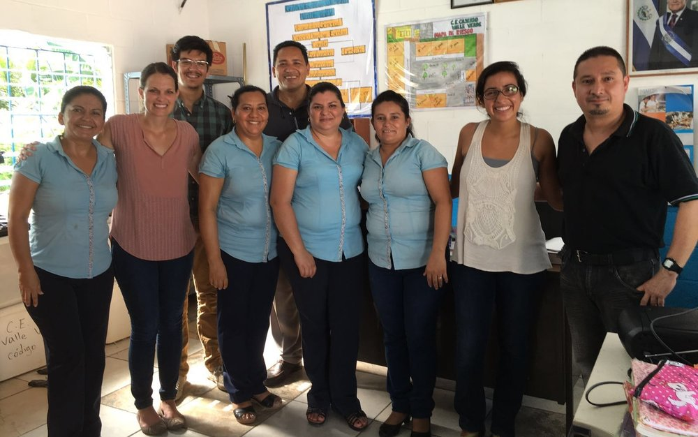 The teacher on the far right, attended our seminar.  We were able to visit his school and assist him in his classes for a day.  We were also able to gift the rest of the staff who work there with school supplies.