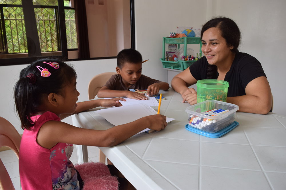 During Leafa's study abroad in the Philippines, she is assisting with several students in an after-school tutorial program.