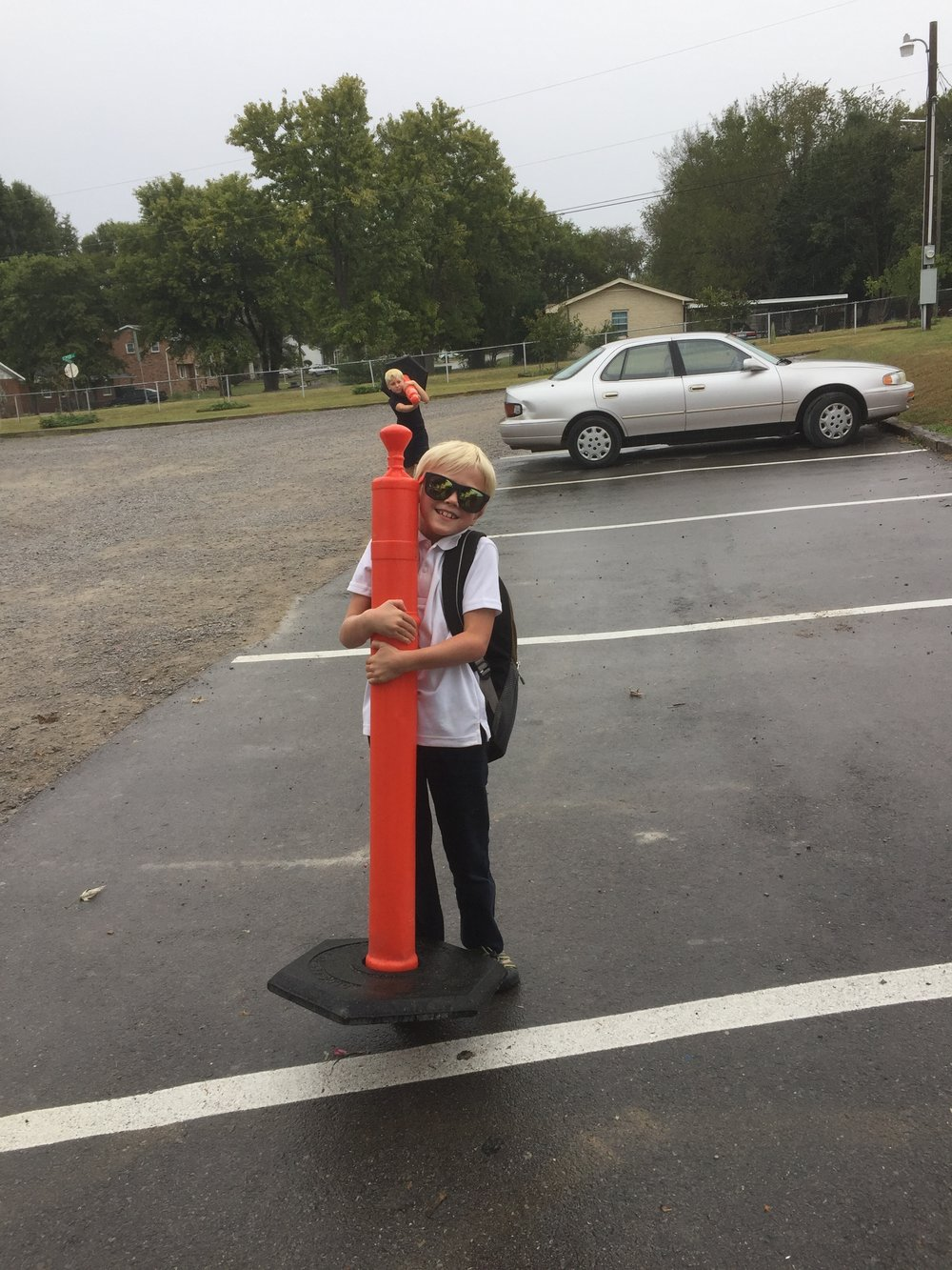 I love this picture of the boys. At dismissal time Elijah and Isaiah ran to help the traffic guard pick up the cones and put them away!