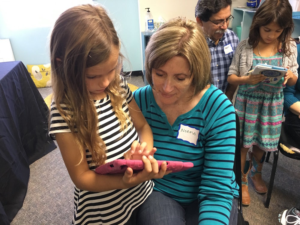 Sophia enjoys having her grandma, known as GG to her grandkids, in Bones & More Muscles class on Friday. Here, she is showing GG some of her anatomy apps that have aided in her ability to learn anatomy so well. The students were blessed by the presence and care of their grandparents all day and loved getting to show them all that they are learning. It was a special time indeed.