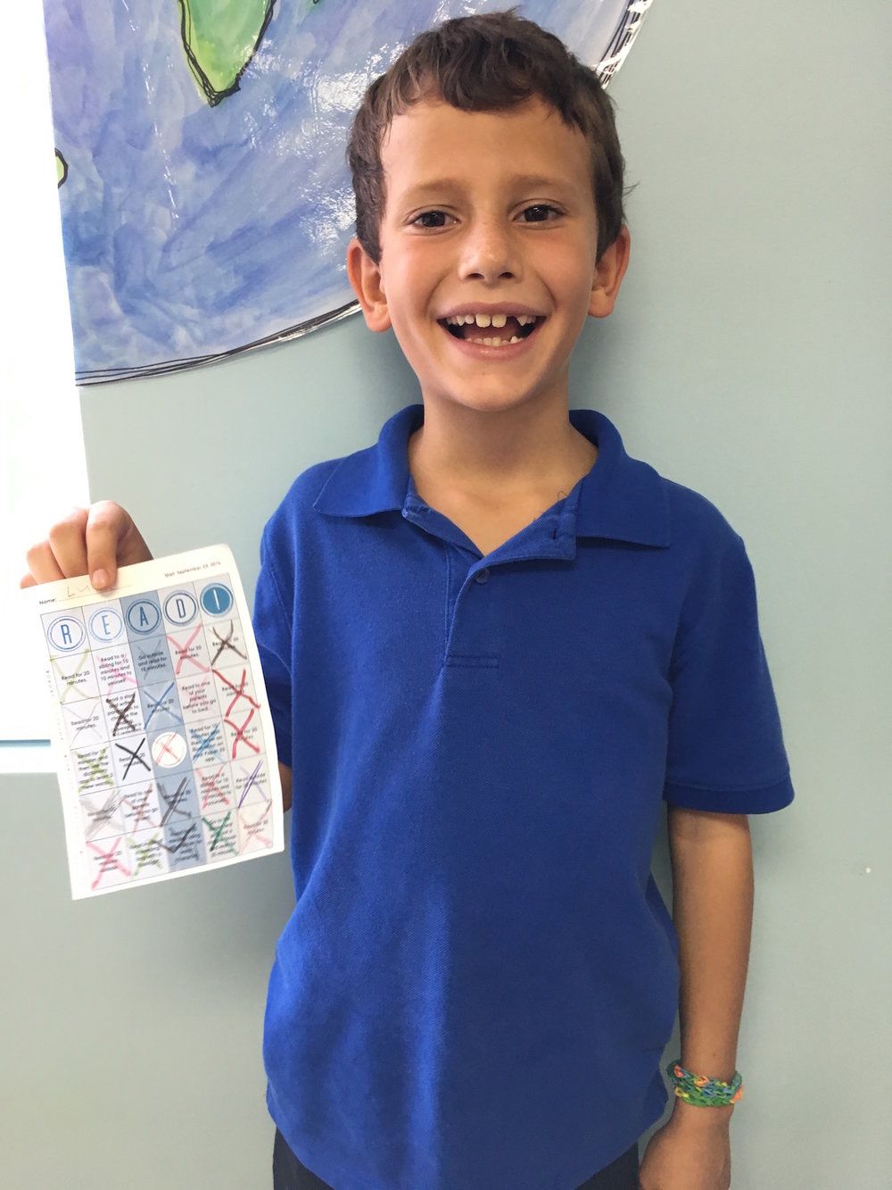 Luke was all smiles as he returned his READ! chart to school on Monday.