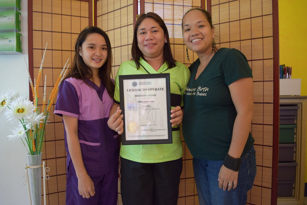 Our cooperative, Rina Escosura (right), stands with a midwife from Cumpio Midwife Clinic.  They show off their certificate for operation after they had to rebuild the facility from ground up after the typhoon. But even in the immediate aftermath, the Cumpio staff was faithful to continue serving women who needed labor support in such a vulnerable time.