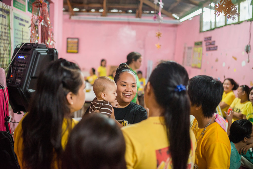 Team member Rina Miller visits with the ladies at the Tacloban City prison after a time of encouragement.