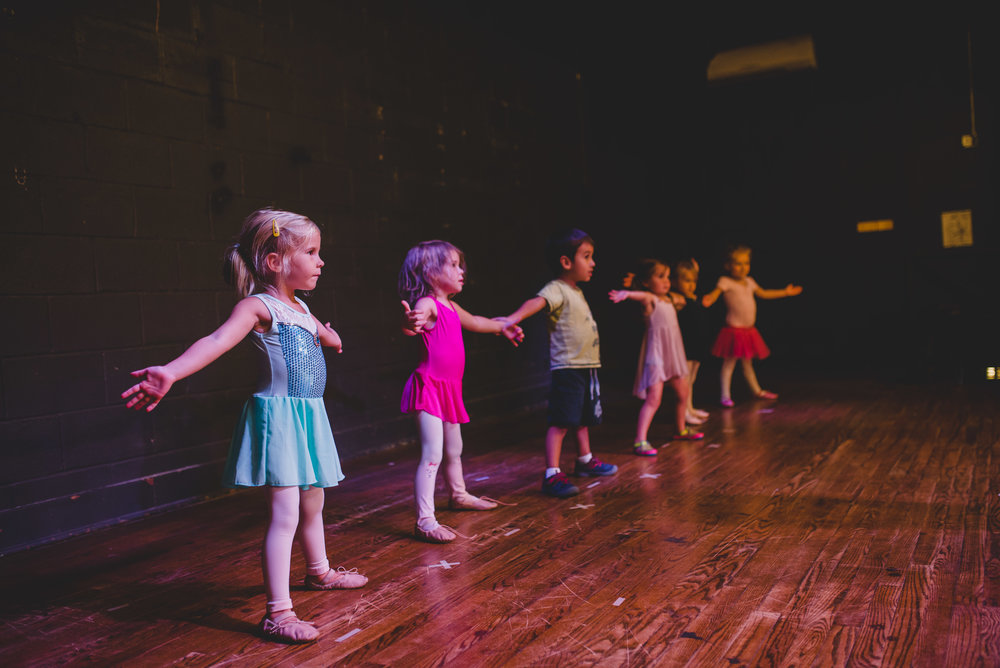 The 3 and 4 year old class is introduced to basic foundational concepts of dance, and have a great time learning to coordinate their bodies in ways they never have before.