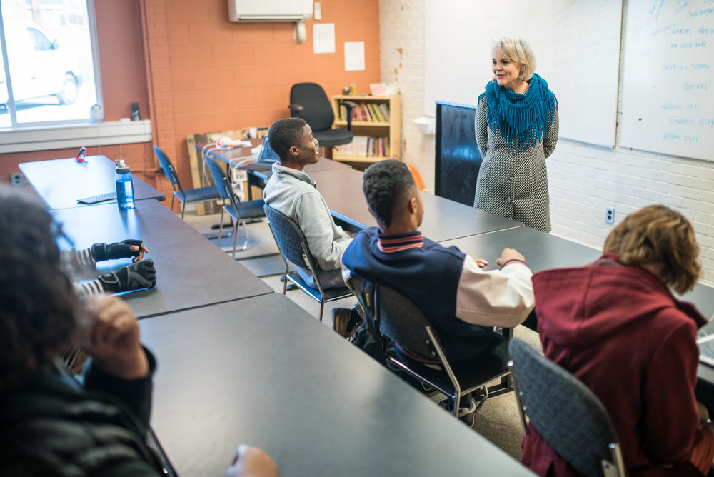 Bridging the generations: Rosemary Sherrod, a boomer, teaches a Black History class for high school students of the unnamed generation at the Academy for G.O.D. Rosemary has caught on to Gregg's concern for remaining relevant--she is one of the most beloved teachers at the Academy.