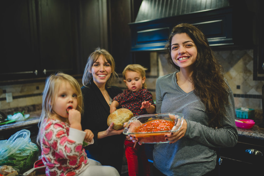 Kendice Hartnell, left, with her two children, sharing her ministry of meal-making with an Institute student.