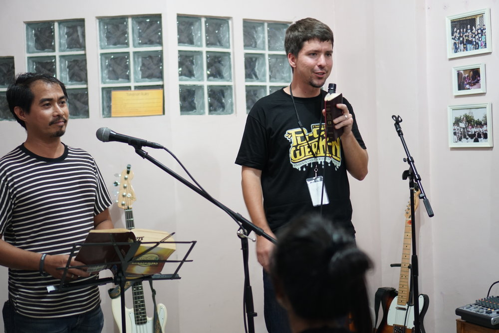 Ty Mathews preaches at the SLAM Youth Weekend while our friend and ministry partner Pastor David Pica helps translate and add in a little humor of his own.