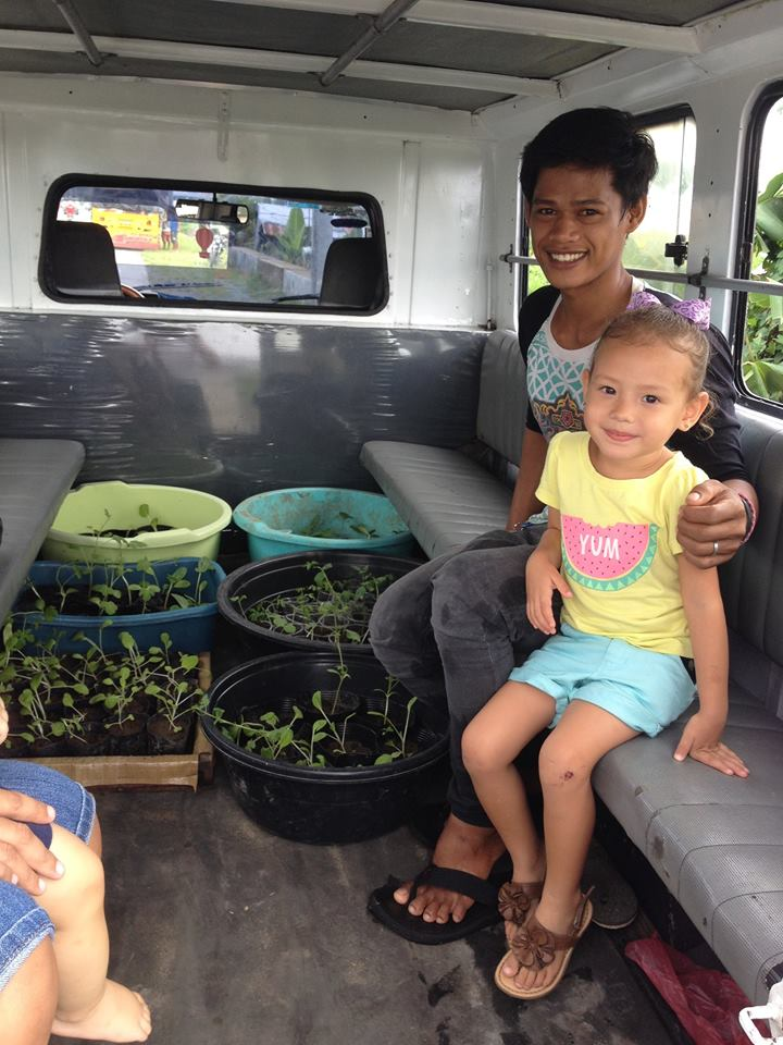 Ayok and Kazeema prepare to transport starter plants to nearby Baras Elementary School to contribute to their school garden.