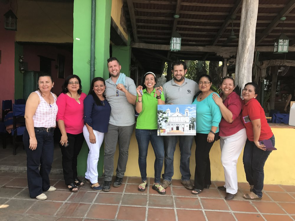 Matthew Parker, Lavinia Fernandez and Marco Arroyo (3 middle) amidst a team of grateful teachers, showing off their gifts of gratitude--tokens the whole team treasures on the other side of their hard work.