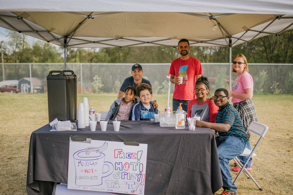The business creation workshops culminated in a Mexican Hot Chocolate booth at a local fall festival celebration. Students worked together to create the booth, produce marketing materials, and provide excellent customer service!
