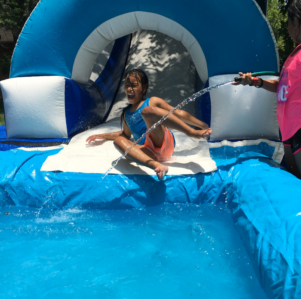 The water slide was an added surprise at the end of the week, paid for by one of the youth groups working the camp.