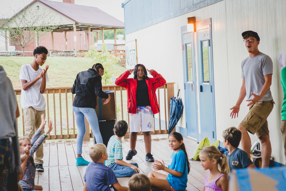 Austin Milliron, standing right, is a student at the Institute for G.O.D., spending his summer working with youth, practicing some of the leadership and organizational principles he's been taught in the classroom.