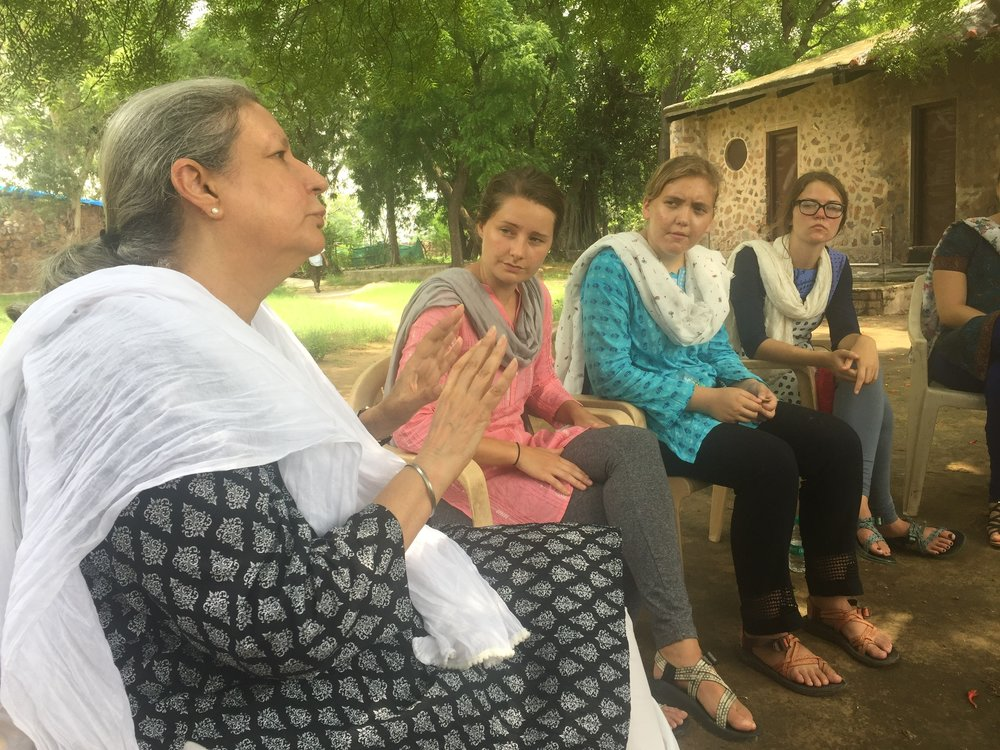 The team meets with the founder of the Kabliji Rural Hospital to learn more about the plight of women in India.