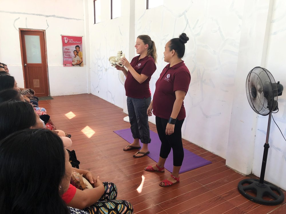 Kristin Bennecker and Rina Miller co-taught a childbirth education seminar for nearly 60 expecting women in the Philippines last month.