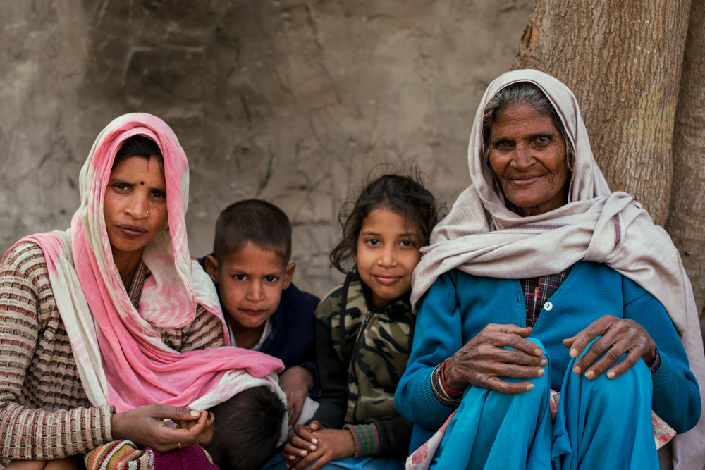 Rakhi, alongside her daughter-in-law and three of her grandchildren, all of whom she delivered.