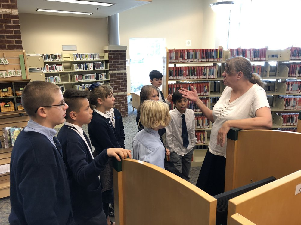 Students are receiving a guided tour by the hermitage branch reference librarian so they can find what they are looking for faster. The place is pretty big and navigation can be a little overwhelming without the right knowledge.