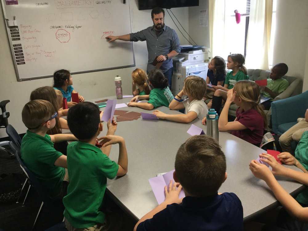 Mr. Streeter is using Origami to teach introductory principles of Geometry.  Check out this article  to read more about the many academic benefits that can be drawn from using Origami in school!