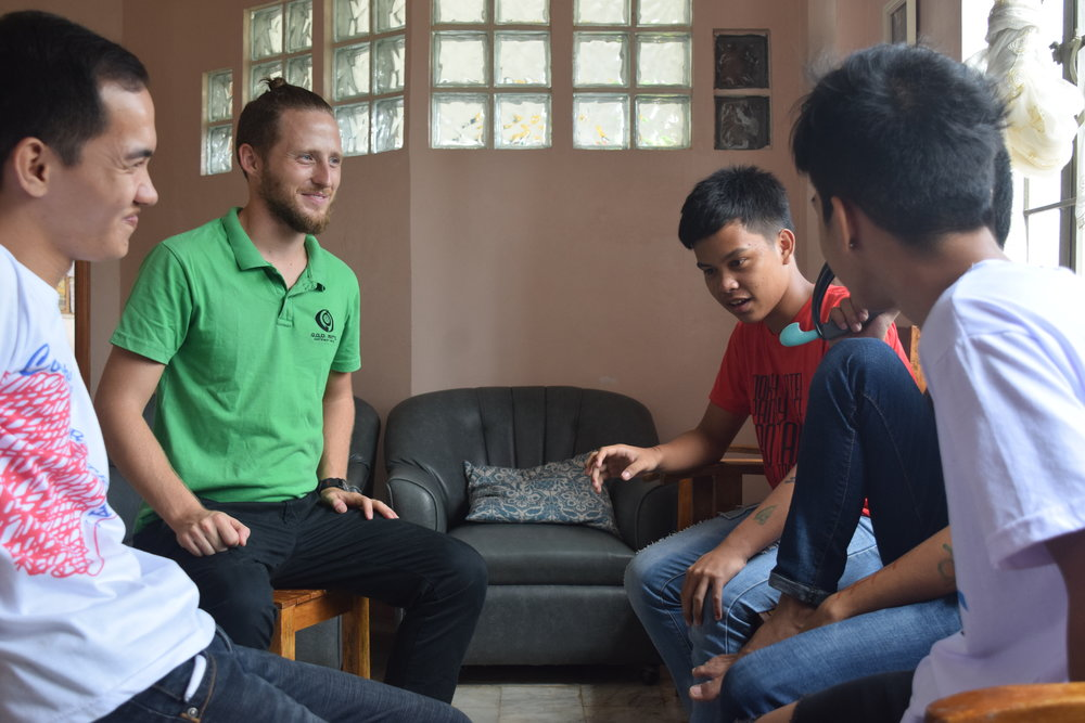 Clark Miller, who manages the PAS program, spends time interacting with some of the new participants.