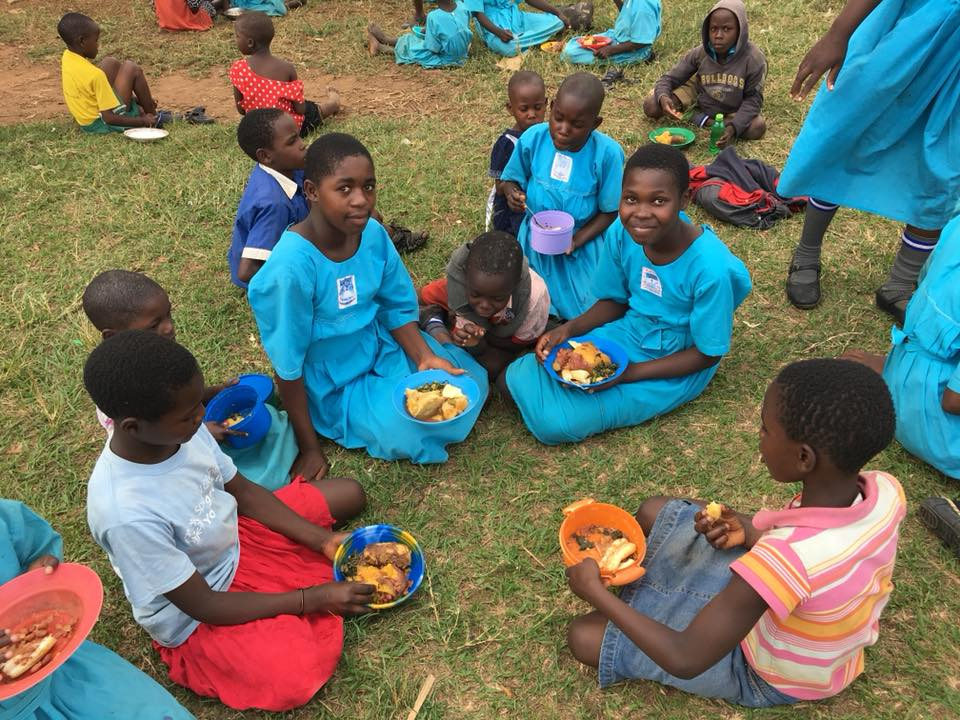 As you can see in this picture, children are receiving colorful plates of nutritious food!