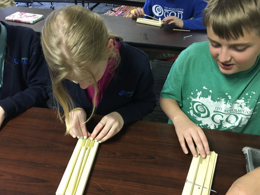 In Instrument Design, they learned how length and width of parts of the instrument, determines the rate of vibrations making various notes!