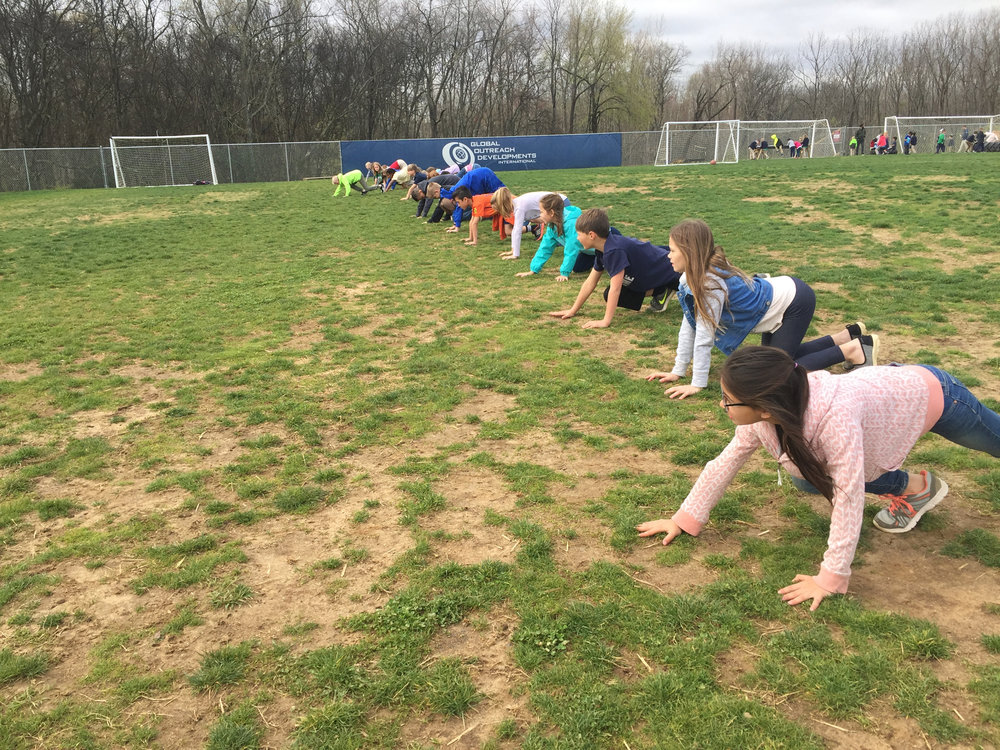 Students learned several exercises that would strengthen their core and increase their flexibility to help them with gymnastics.