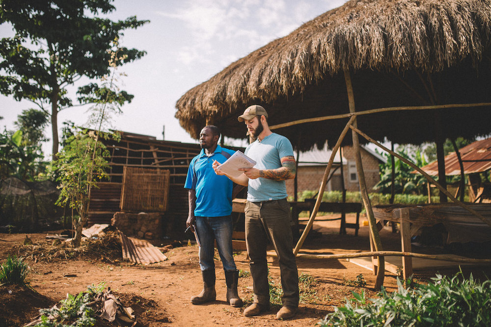 Lubega Francis, Property Manager and Geoff Hartnell, Hopewell Farms Manager, discuss the best utilization of space for the most efficient yield of crops on our land in Uganda. (2018)