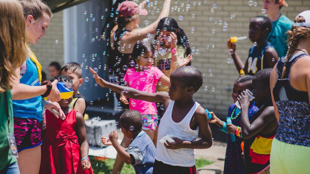 bubble blowing w kids.jpg