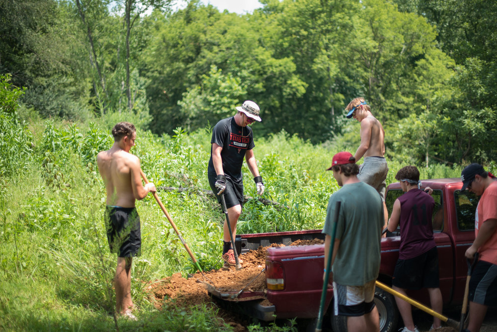 Guys Unloading dirt from truck.jpg