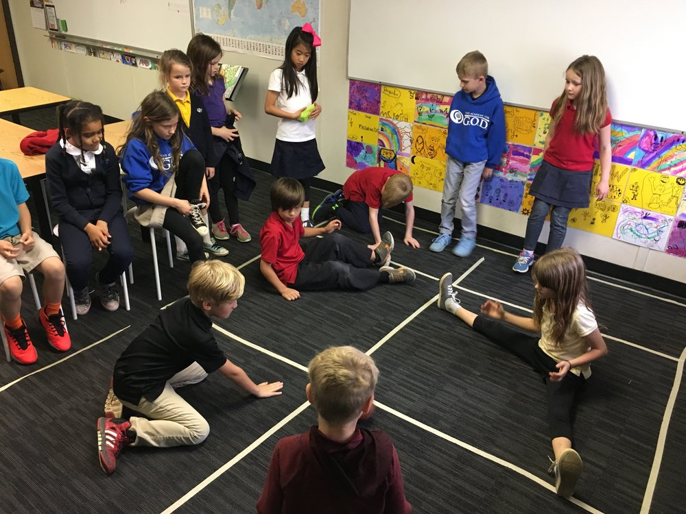 One of the many indoor recess games these students have created is a sitting version of four-square which involves rolling, bouncing, and the same competitive nature to get to the top square.