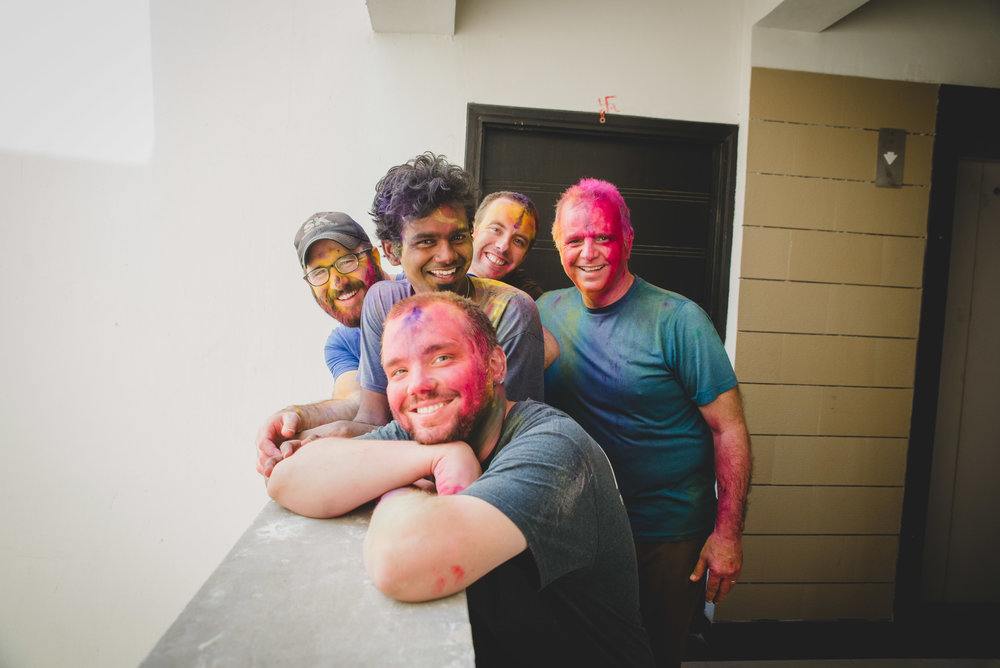 During Holi festivities you can't walk down the street without experiencing the rain of color! Celebrants bring in the coming of spring by throwing vibrant colors into the air and at one another. The colors mimic sprouting vegetation and the coming rain. From left to right: Taylor Maute, Stephen Carver, Manohar Paul, Andrew Bartlett, and Scott Sherrod enjoy time together during the Holi Festival.