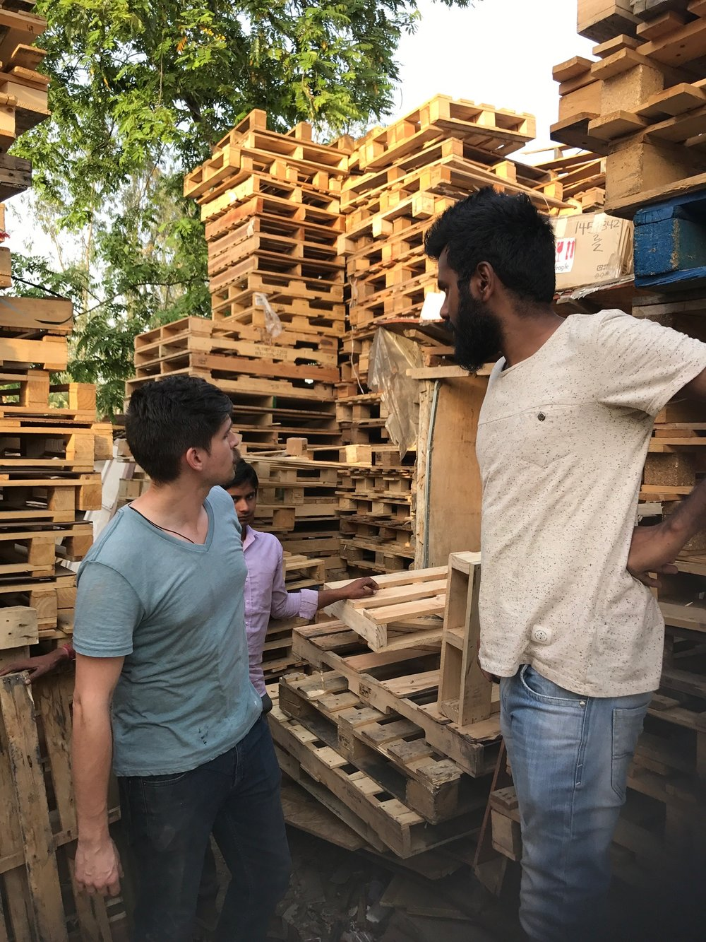 India team member Josh Nava searches for affordable local materials, to be used for a hospitality space in the G.O.D. India offices. Pallet wood furniture proved a versatile option, and is a skill that Josh has already developed over years of practice.