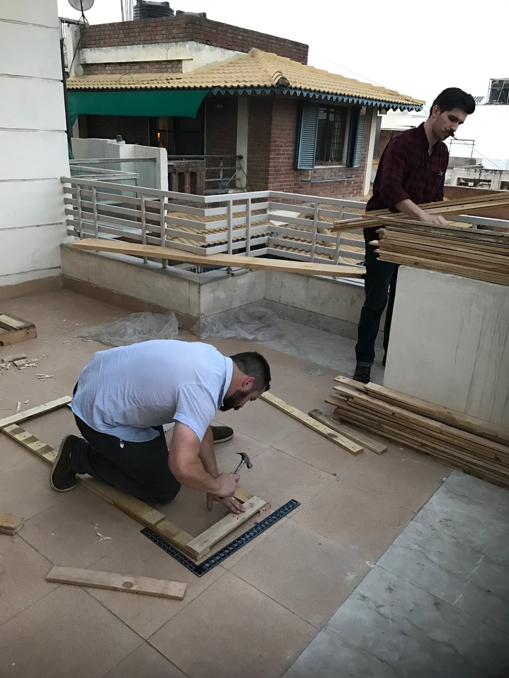 Corey Streeter builds a frame for wall art installation. Because of the creativity and diligence of trip participants we were able to save hundreds of dollars in outfitting our office building- dollars that can instead be directed to those in need.
