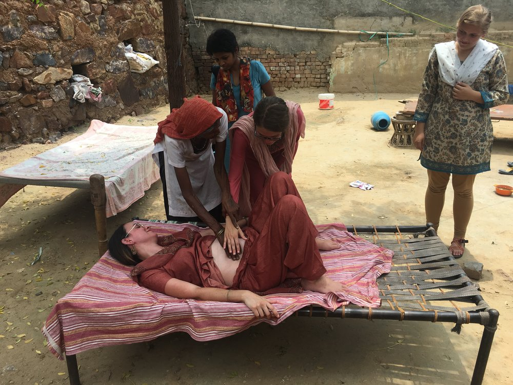Interns got the privilege of visiting a village midwife, or 'dai' in Hindi. This dai is a 70 year old woman who has dedicated her life to serving women through childbirth. G.O.D. Institute student Darbie Guess got a hands-on lesson in doing a prenatal checkup on team member, Stephany Dailey.